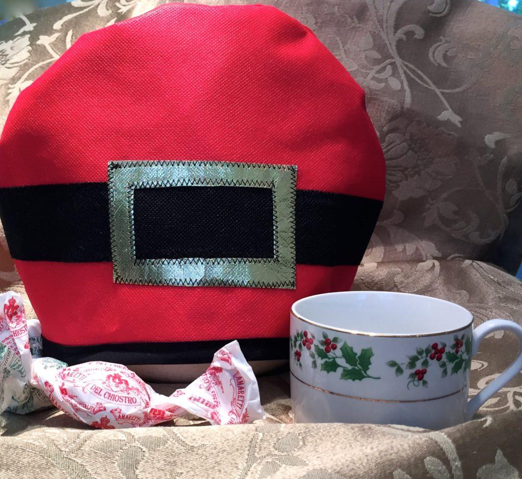 """H0-H0-H0 Santa's Holding the Tea pot warm"""