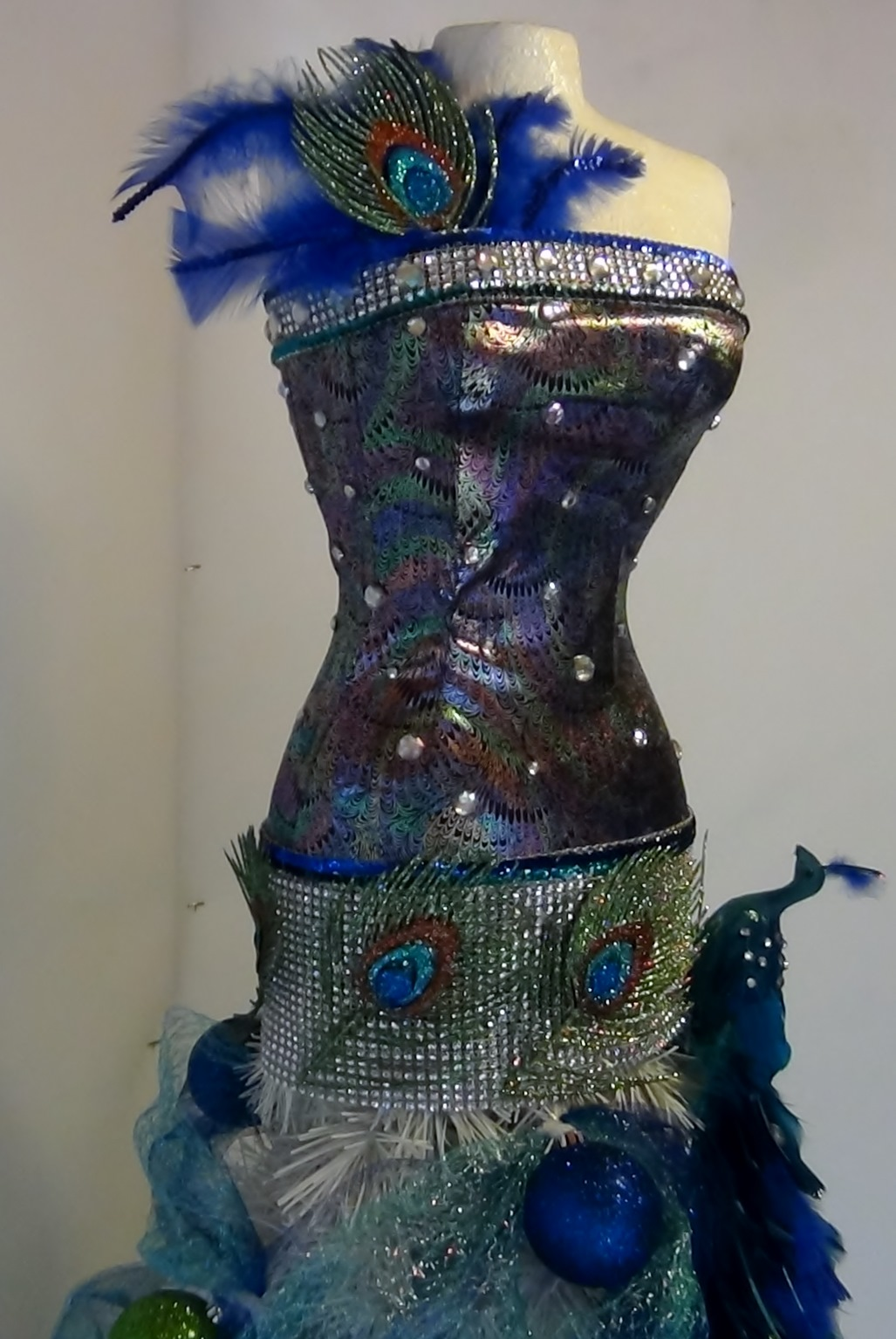 Mannequin Christmas Tree With A Peacock Theme Seams And
