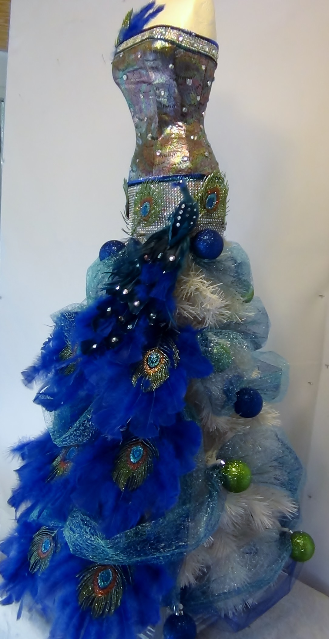 Christmas Tree Mannequin Dress.Peacock Themed Mannequin Christmas Tree Seams And Scissors