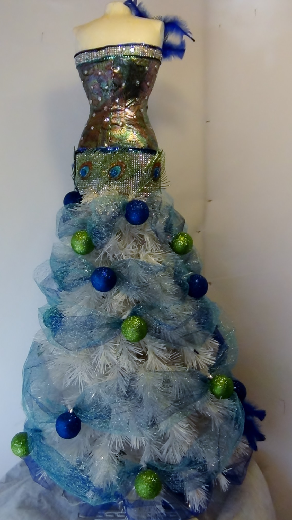 Mannequin Christmas Tree With A Peacock Theme - Seams And ...