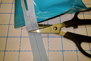 Use cheap or paper scissors to cut zipper
