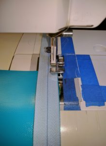 Blue Vinyl Zipper Half Being Stitched