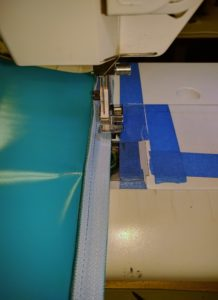 Blue Vinyl Zipper on Sewing Machine