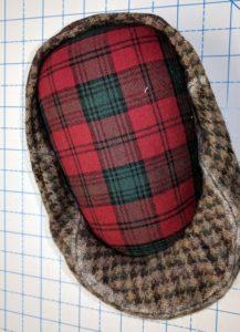 Ironing Ham shown inside of flat cap.