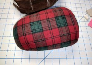 ironing ham, green and red plaid