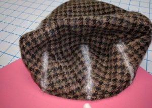 back view of flat cap with chalk marks