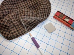 Flat cap with several different types of sewing chalks