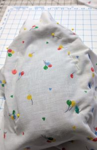 Pin it well to keep the fabric in place whilst you find the seams