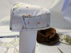 Flat Cap sewn and rightside out on stand